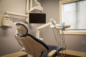 A dental chair and tools in an office