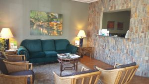 The waiting room and front desk of a dental office